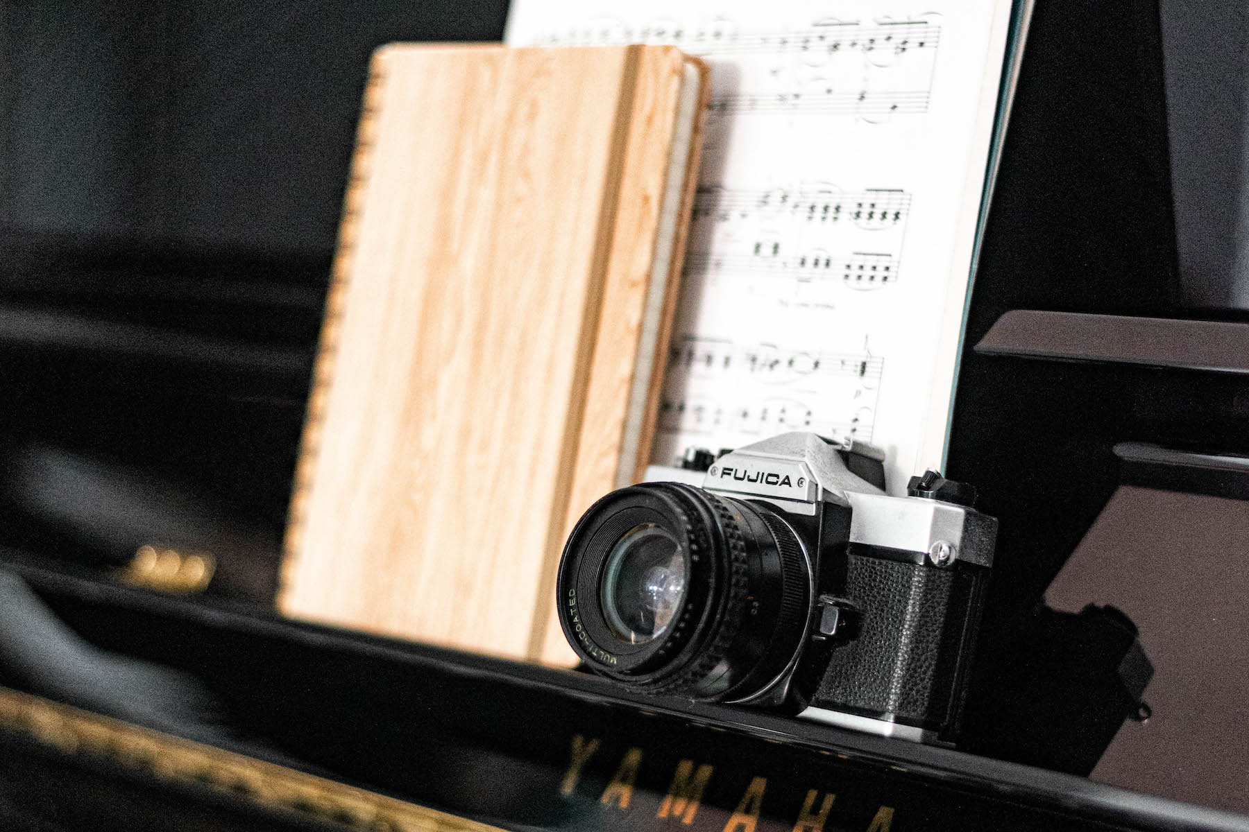 Fujica SLR on piano music desk | madofmint.net
